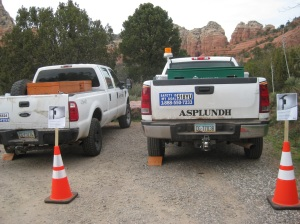 Trucks parked behind cones