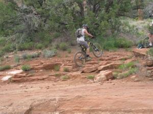 Bike Rider on Rocks