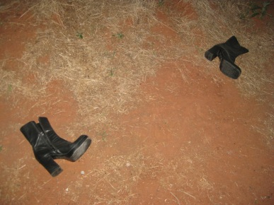 A pair of boots in the dirt