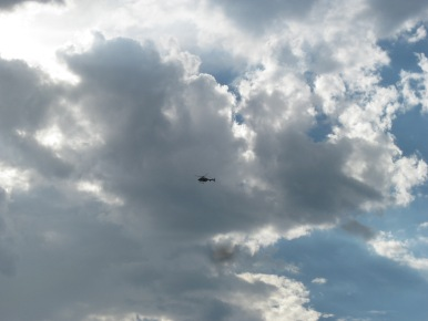Helicopter flying under clouds
