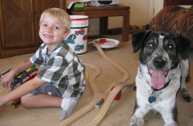Bongo and his friend on opposite sides of the train tracks