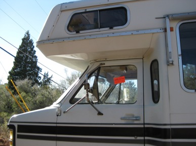 RV with a Police Sticker in the Window