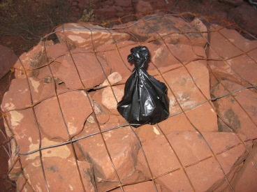 Little black bag on top of a cairn