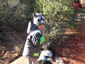 Bongo meeting a boy with a raccoon hat