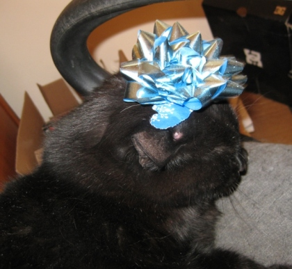 Scratchy with a blue bow on his head