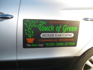 Touch of Green sign on car