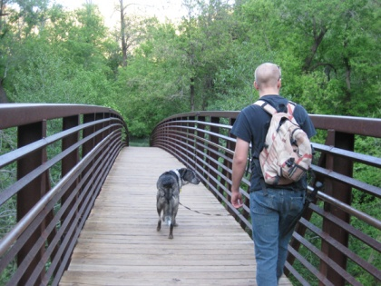 Bongo and his younger person walking across a bridge