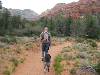Bongo and his younger person walking on the trail