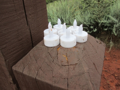 Seven electric tea lights on a post