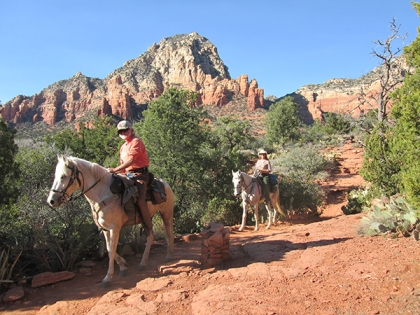Two horses on the trail with Thunder Mountain in the background
