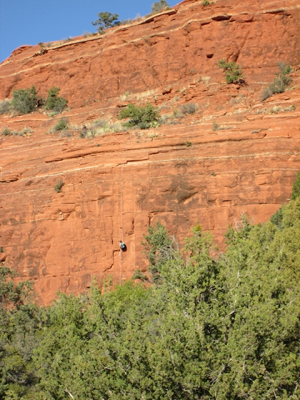 Person rappelling down Sugarloaf