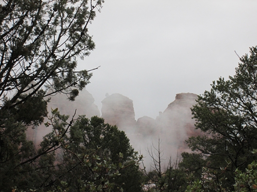 Red rocks covered in clouds