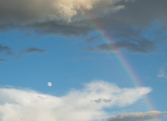 Rainbow, clouds, and moon