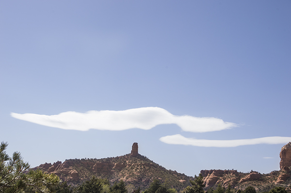 Wind blown clouds over Chimney Rock