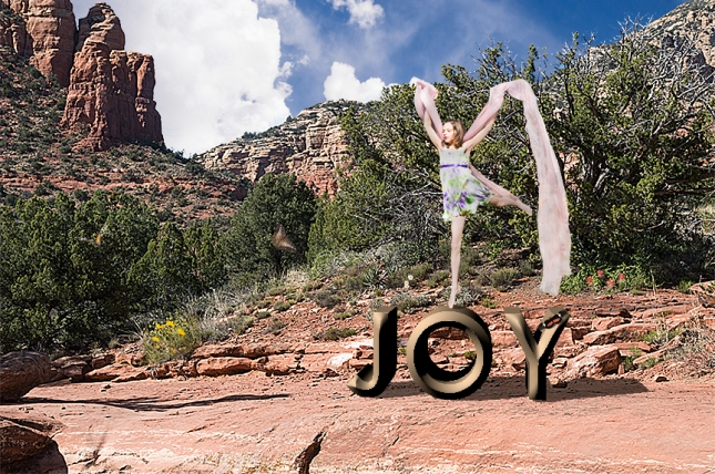 Girl dancing on top of the word JOY