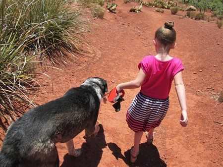 Bongo and the girl walking down the trail