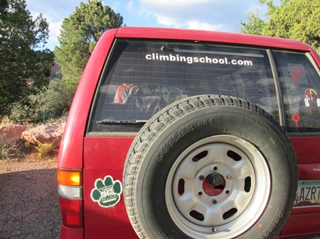 Red vehicle with paw and climbing school sign